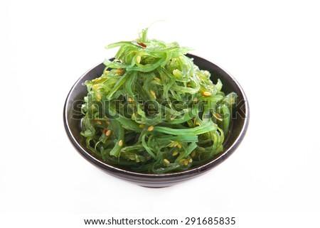 Japanese Cuisine , Seaweed Salad in black bowl on white background - stock photo