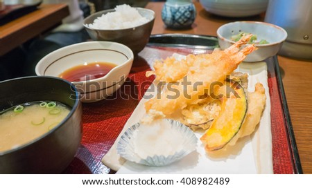 Japanese Cuisine - Set of Tempura Shrimps (Deep Fried Shrimps) with sauce and side salad - stock photo
