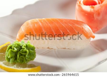 Japanese Cuisine -  Smoked Salmon Nigiri Sushi with Ginger and Wasabi - stock photo
