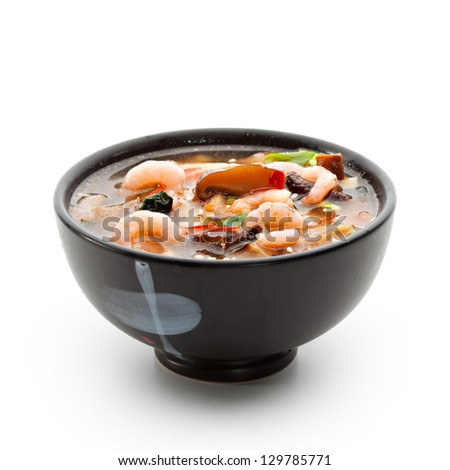Japanese Cuisine - Suimono Soup made of Fish, Pork, Mushrooms, Shrimps and Noodles (Udon). Garnished with Pepper, Spring Onions and Sesame - stock photo