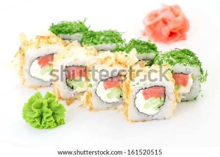 Japanese cuisine - sushi and rolls on a white background