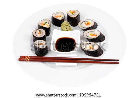 Japanese Cuisine : Sushi Maki Roll with Salmon and tuna inside . on white dish with sticks isolated over white background - stock photo