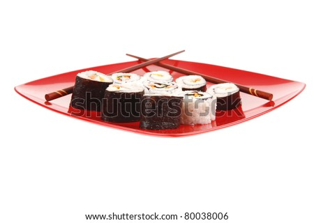 Japanese Cuisine : Sushi Maki Roll with Vegetables and Salmon inside . on red dish with sticks isolated over white background - stock photo