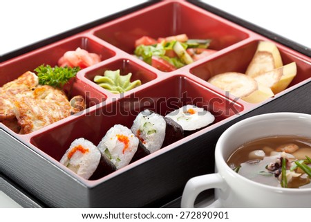 Japanese Cuisine - Sushi Roll with Appetizers, Dessert and Soup - stock photo
