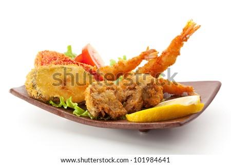 Japanese Cuisine - Tempura Food: Deep Fried Shrimps, Vegetables and Mushrooms - stock photo