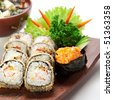 Japanese Cuisine -Tempura Maki Sushi (Deep Fried Roll made of Smoked Eel, Crab Meat and Cream Cheese inside) with Spicy Salmon (sake) Gunkan Sushi and Miso Soup (Seaweed, Mushrooms and Tofu Cheese) - stock photo