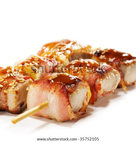 Japanese Cuisine - Tuna Wrapped in Bacon on Skewer - stock photo