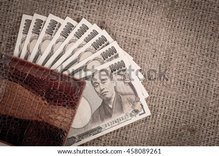 Japanese currency, bill yen in a crocodile texture Wallet, a copy space.