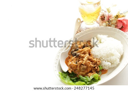 Japanese curry rice, Shimeji mushroom and pork with iced tea on background - stock photo