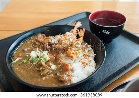 Japanese curry rice with shrimp tempura - stock photo