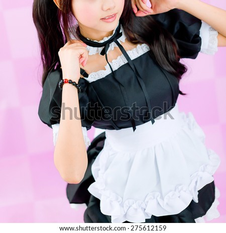 japanese cute lolita maid in pink background - stock photo