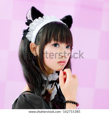 japanese cute lolita maid thinking in pink background - stock photo