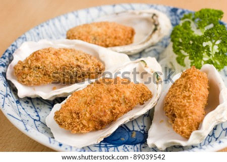 Japanese deep fried breadcrumbed oysters in a half shell - stock photo