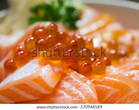 "Japanese Dish ""Salmon Ikura Don"" made from fresh salmon and salmon roe served with Japanese rice, Selective Focus, Texture / Pattern - stock photo"