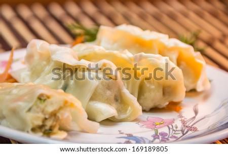 Japanese Dumplings with chopsticks - stock photo