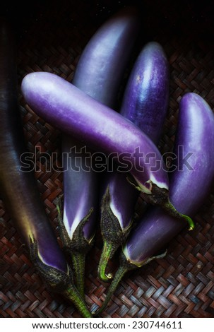 Japanese eggplant in a basket - stock photo