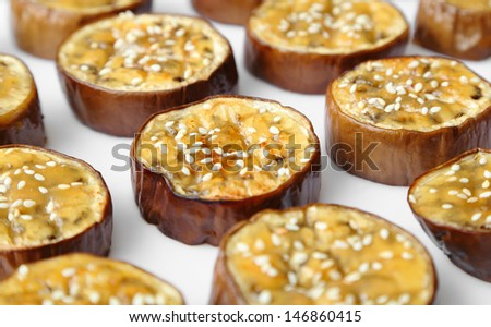 Japanese eggplant sliced, grilled, and covered with a sweet miso sauce. - stock photo