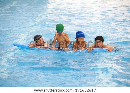 Japanese family swimming in the pool