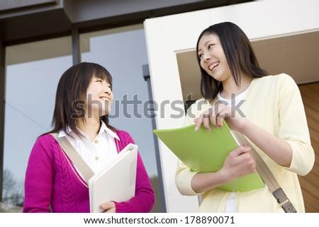 Japanese Female students talk - stock photo