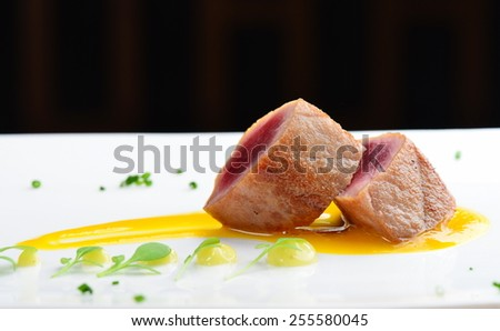 Japanese fine dining, Seared tuna steak called Sashimi traditional Japanese dish with wasabi sauce on side - stock photo
