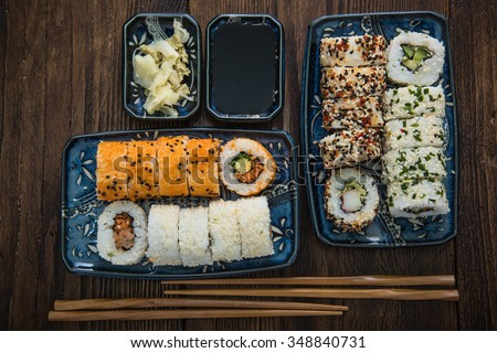 Japanese food, california style rolls from above on wooden table - stock photo