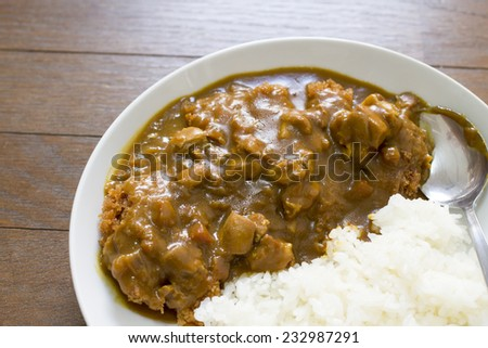 Japanese food deep fried pork with  curry on wood pattern  - stock photo