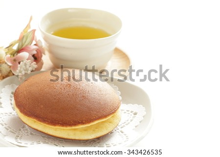 Japanese food, Dorayaki Pan cake with green tea - stock photo
