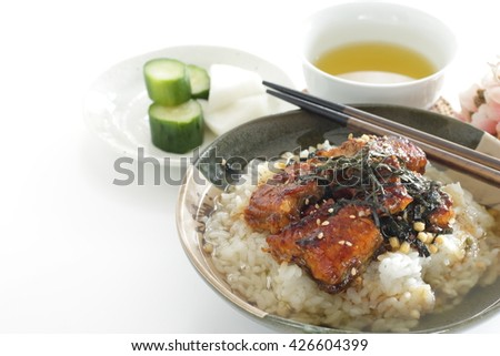 Japanese food, grilled eel on rice with green tea for regional food image Hitsumabushi  - stock photo
