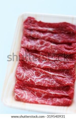 Japanese food ingredient, Marble beef sliced for Sukiyaki cooking - stock photo