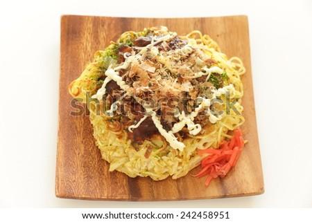 Japanese food, Modanyaki Ramen noodle Pan cake in Osaka style - stock photo