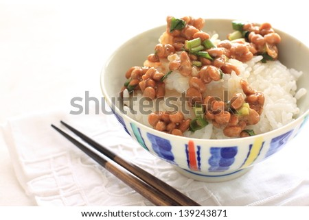 japanese food, Natto on rice and chopstick on white background with copy space, - stock photo