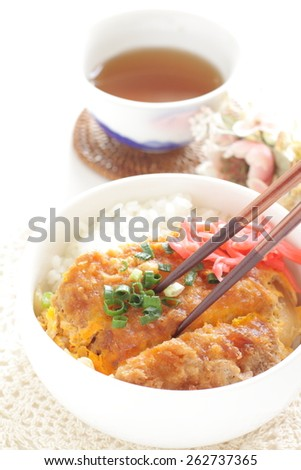 Japanese food, pork cutlet on rice with barley tea - stock photo