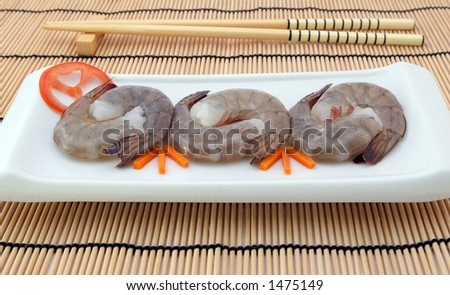 Japanese food,  raw gourmet sushi, tiger king prawns served with a carrot and tomato garnish with copy space, - stock photo