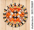 Japanese food restaurant delivery - sushi maki california roll platter set isolated at wooden background, above view - stock photo