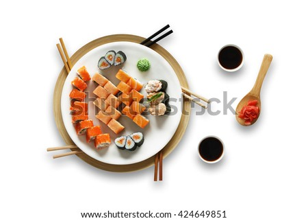 Japanese food restaurant, salmon sushi gunkan roll plate or platter set. Set for five with chopsticks, ginger, soy sauce and wasabi. Sushi isolated at white background. Top view, Flat lay - stock photo