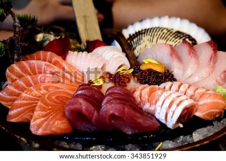 Japanese food Salmon roe,Sea urchin,Tuna (Sashimi set) - stock photo