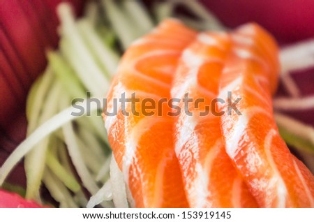 Japanese food, salmon sashimi in bento box.