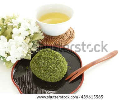 Japanese food, seaweed sticky rice ball Ohagi with green tea - stock photo