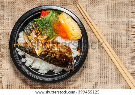 Japanese food style , Saba fish grilled set with rice on cloth background in still life style - stock photo