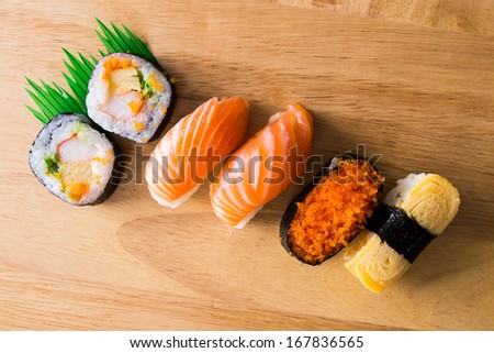 Japanese food sushi  roll, Maki on wood cut board - stock photo