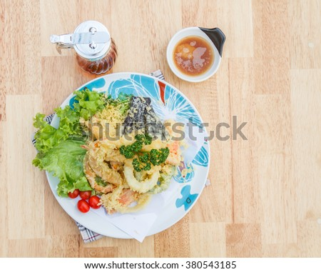 Japanese Food Tempura Mix ingredients are shrimp, carrot, pumpkin, eggplant and onion on wooden table. Top view. - stock photo