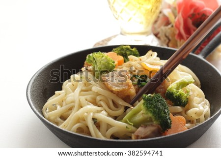 Japanese food, udon noodles and fried chicken stir fried with tea - stock photo