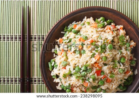 Japanese fried rice with egg vegetables close up on a plate and