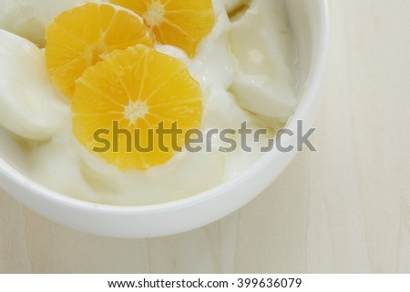 Japanese fruit Shonan Golden sliced on yogurt served with honey