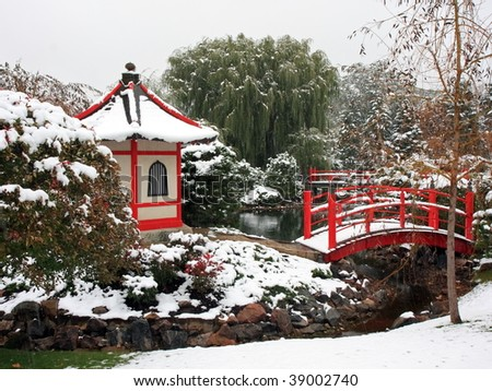 Japanese garden in Bloomington during snowfall - stock photo