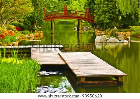 Japanese garden scene - jetty and bridge in the background