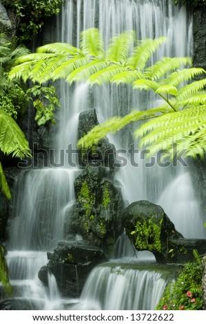 Japanese garden waterfalls, slow shutter. - stock photo