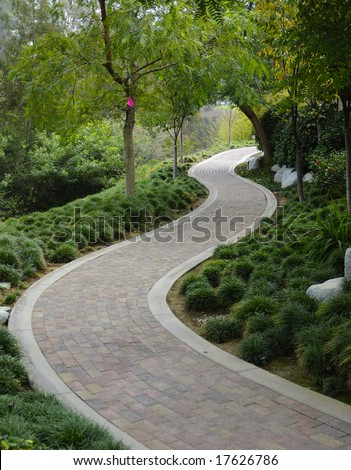 Japanese Garden with paving stone walkway - stock photo