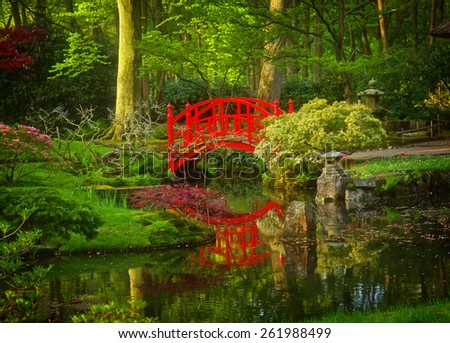 Japanese garden with red bridge, Den Haag, Holland, retro toned - stock photo