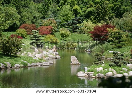 Japanese garden with typical trees and pond. - stock photo